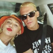 Miley Cyrus and Cody Simpson inside a car